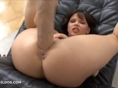 Brunette Hair bonks herself with a large beige marital-device