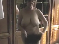 Busty mature wife undressing