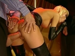Blond bitch in latex double-teamed (Brigitta Bui)