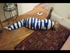 Mummified girl struggles