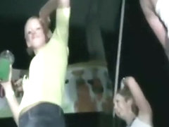 Girls in miniskirts dancing in the club