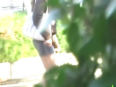Asian babe wearing no panties gets street sharked in a park.