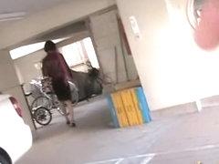 Asian babe unlocking her bike gets a skirt sharking.