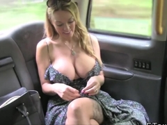 Busty blonde takes off panties in fake taxi