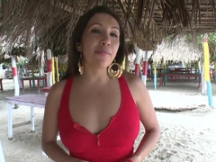 Amateur doll Angelina looks horny on the beach