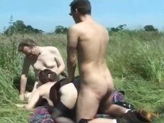 British whore acquires screwed in the field in a FMM three-some