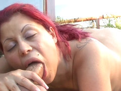 Sexy pregnant redhead is outdoors sucking and riding