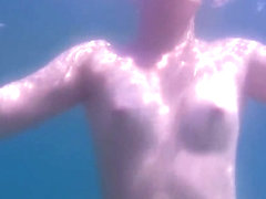 Teen Swimming Naked in the Sea Underwater