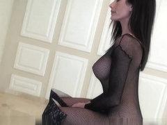 Erotic erection controlling beauty in bodysuit
