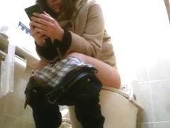 Japanese women caught by hidden spy cam in toilet