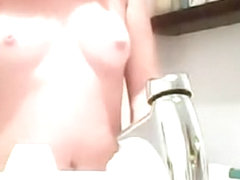 Cute tits in the bathroom mirror
