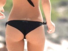 Massive natural tits on a beach