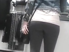 Girl in tight pants at store