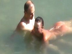 Nudist couple enjoying the fresh water