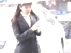 Rainy street sharking scene of some truly glamorous Japanese chick