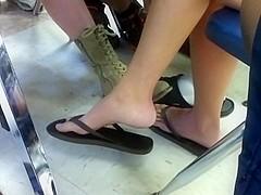 Girl dangling flip flops during lunch