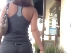 Big ass woman in tight gray sports shorts