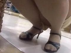 Asian store worker upskirt