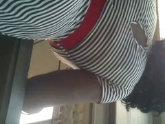 Black girl is having her sexy red panties flashed on camera