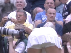 Sweaty tennis babe bending over after match