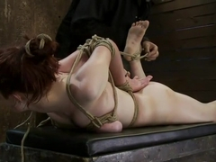 Hot 19 yr old suffers a category 5 Hogtied suspension. Isis Love makes her cum over and over