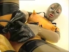 Angel in rubber masturbates