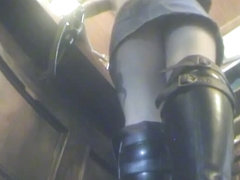 Upskirt with a kinky babe wearing leather boots