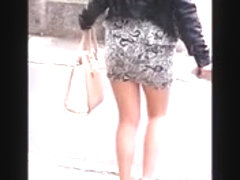 Girl with sexy legs in mini skirt, pantyhose and high heels