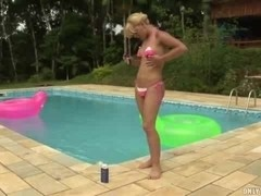 Ardent blonde beating off near the pool