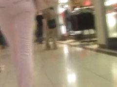 Candid public clip of a hot girls jean ass walking