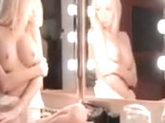 Teen blonde beauty teasing her big boobs in mirror