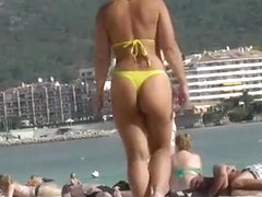 Sexy ass woman in yellow thong bikini