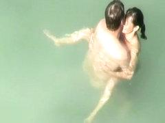 Nudist sex in the water