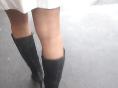 Black boots and tan stockings upskirt