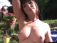 Maria Bellucci waters the flowers and strokes her pussy