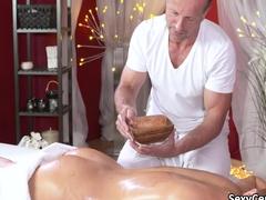 Oiled redhead fucked on massage table
