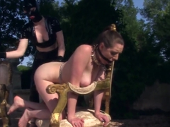Latex Lucy fucks Samantha Bentley in garden