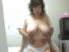 Nasty masseur fucking big titted Asian doll on spy cam