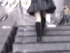 Babe got skirt sharked while climbing the stairs in the mall