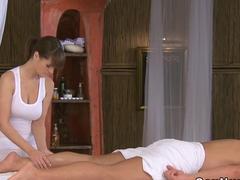 Busty masseuse wanks  cock till orgasm