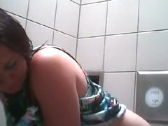 Supple girl spied taking a pee in a toilet