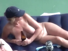 Big tits nudist woman with shaved pussy