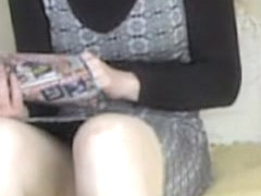 Girl in high boots spied masturbating as reading magazine