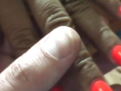 Latina with sexy long orange(different design) nails