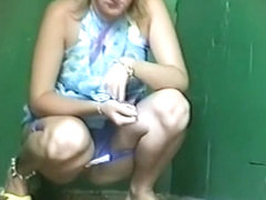 Blonde woman lifts her dress piss