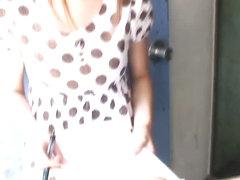 Asian sweetie in a polka dot dress falls prey to a downblouse voyeur