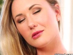 Cute blonde Sam T shows her nice fake tits