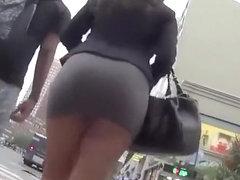 Nice ass girl in tight short skirt upskirt