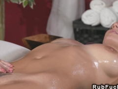 Dark haired lesbo fingeres her masseuse