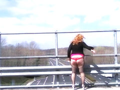 Antonella spanking on highway bridge